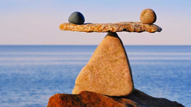 stones-balancing-by-water